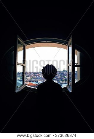 The Man Looking Through The Window Of The City. Man Focused On His Dreams Looking Out Of The City Th
