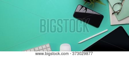 Copy Space On Creative Worktable With Digital Devices And Decoration