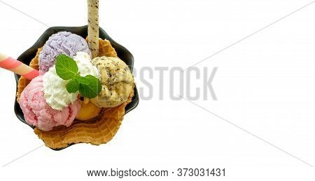 Three Scoops Of Ice Cream In A Waffle, Top View, Isolated In White Background