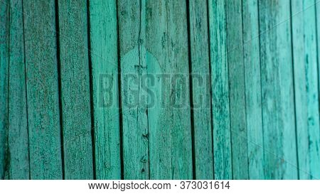 Background Of Green Flaky Wood. Backdrop Of Green Colored Wooden Panels With Aged Flaky Surface