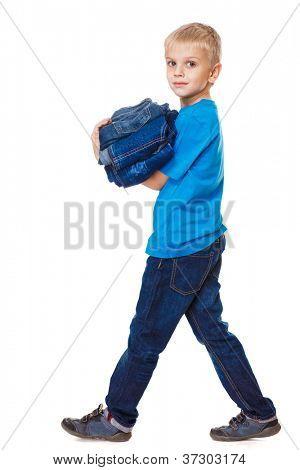 Boy holding jeanswear in hands