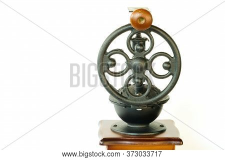 A Vintage Coffee Grinder With Intricate Metal Part, Isolaed On White Background