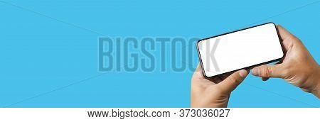 Man Using  Mock Up A Cell Phone With Blank Screen Space Banner