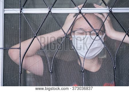 Portrait Of Young Asian Woman Having Headache, Quarantine Herself In Her Home In Covid-19 Pandemic O