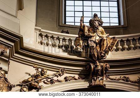 Lviv, Ukraine - October 23, 2019: Gilded Male Statue Near Balcony With Balustrade In Dominican Churc