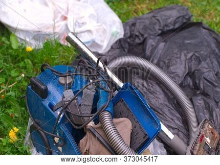 Discarded Damaged Vacuum Cleaner Left With Garbage, Outdoor Closeup