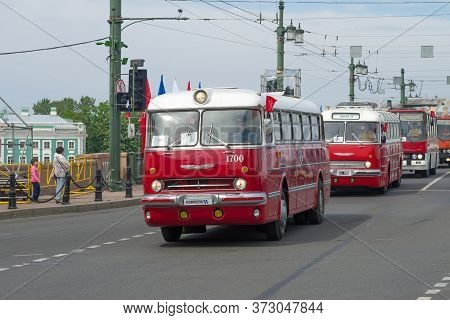 Saint Petersburg, Russia - May 25, 2019: Convoy Of Red Buses Ikarus On Retro Transport Parade