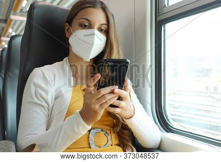 Relaxed Woman With Kn95 Ffp2 Face Mask Using Smart Phone App. Train Passenger With Protective Mask T
