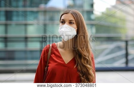 Sense Of Bewilderment. Young Woman In Empty City Street Wearing Protective Mask. Girl With Face Mask