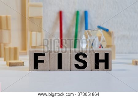 The Word Fish Written In Vintage Ink Stained Wooden Letterpress Type In A Partitioned Printers Drawe