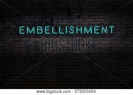 Neon Sign On Brick Wall At Night. Inscription Embellishment