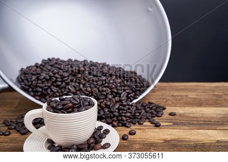 Close Up Coffee Bean In White Cup With Black Background