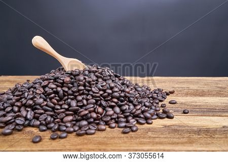Close Up Wood Spoon Put On Pile Of Coffee Bean