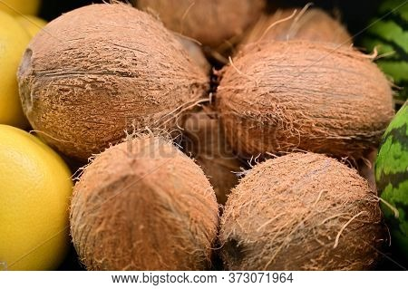 Photo Of Coconut Fruit In A Store Ready For Sale On A Tray