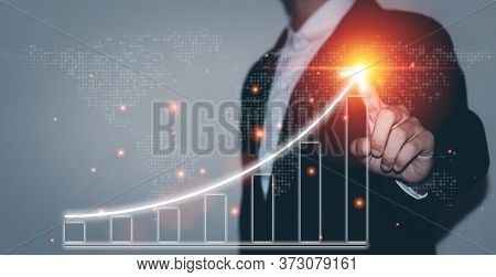 Business Planning And Financial Concepts. Businessman Plan Graph Growth And Increase Of Chart Positi