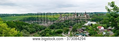 Fortress With Stone Defensive Walls, Bridge And Towers Over The Cliff. Panoramic View Of Medieval Ka