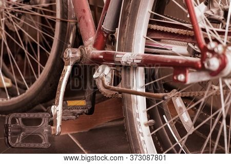 Two Old Dusty Bicycles Standing In Closet Under The Stairs. Close Up Wheel, Spokes, Transmission Cha