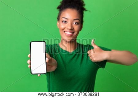 I Like This Cellphone. Millennial African American Girl Showing Mobile Phone With Blank Screen And T
