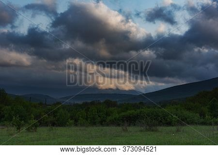 Storm Clouds Over The Forest. Spring Landscape With Large Clouds. Before The Rain. Rural Landscape.