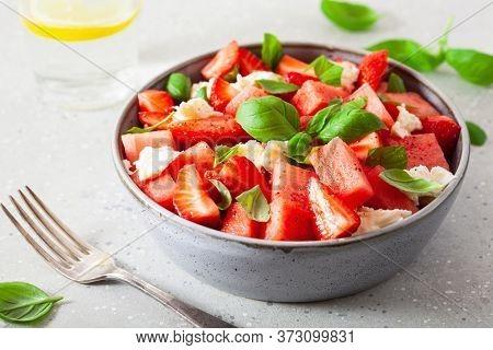 watermelon salad with strawberry mozzarella cheese basil. healthy summer dessert