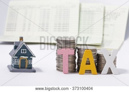 Calculator And Bankbook And Tax Word And Key