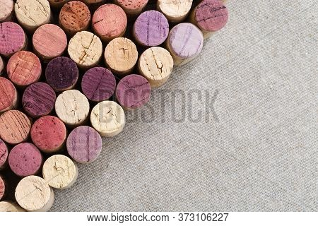 Wooden Cork Close-up Of Bottles With Red And White Wine Located Diagonally. Background Of Wooden Cor