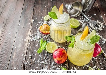 Summer Iced Peach Tea With Mint, Lime And Crushed Ice, Wooden Background Copy Space