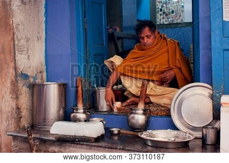 Varanasi, India: Indian Milkman Prepares The Popular Drink Lassi In Fast-food Store Of Historical Ci