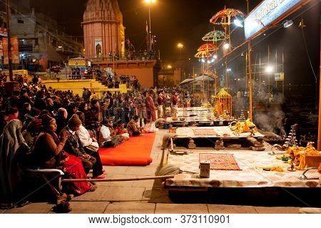 Varanasi, India: Night City With Indian People Praying During The Ritual Dedicated To The River Gang