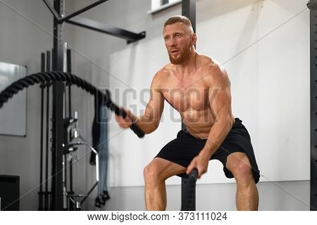 Gym Battle Rope Man Stamina Training Athlete Guy Fitness Exercising Endurance Indoor Workout. Handso