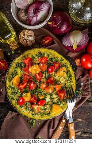 Homemade Rustic Style Frittata. Frittata With Spinach, Cheese And Tomato In Skillet. Wooden Backgrou