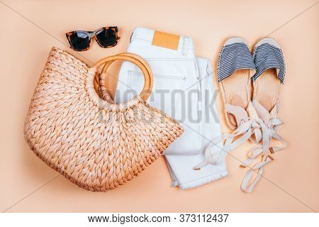 Summer Fashion Flatlay With White Denim Jeans, Summer Straw Bag, Striped Espadrilles Sandals And Tor