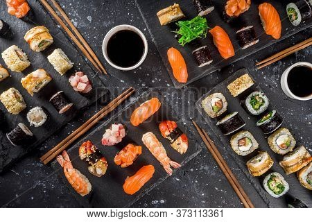 Japanese Food. Big Sushi Set. Assorted Set Of Various Sashimi, Maki And Sushi Rolls With Different F