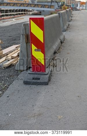 Vertical Panel Barricade Caution Sign At Construction Site