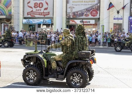 Donetsk, Donetsk People Republic, Ukraine - June 24, 2020: A Military Atv With A Pilot And A Sniper