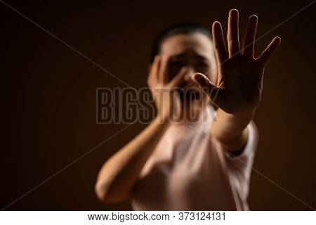 Asian Woman Scared Screaming Covering Face By Her Hands Standing Isolated On Beige Background.