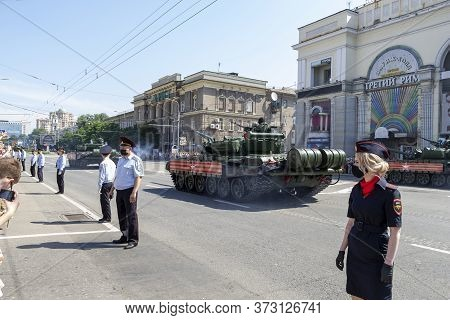 Donetsk, Donetsk People Republic, Ukraine - June 24, 2020: Armored Heavy Soviet Tanks Move Along The