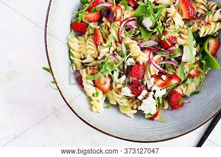 Pasta Salad. Fusilli Pasta - Salad With Strawberry, Feta Cheese, Red Onion And Balsamic Sauce. Top V
