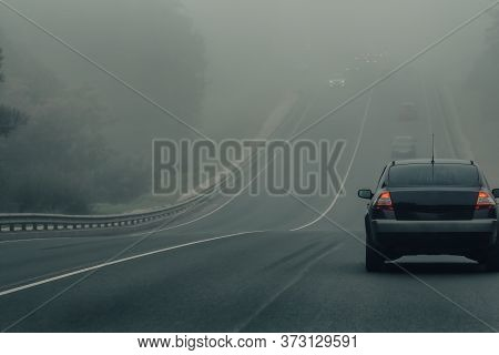 Cars In Fog Driving On Highway In Dangerous Weather. Bad Low Visibility And Auto Traffic On Road. Ve