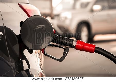 Gun Petrol In The Tank To Fill. Pumping Gasoline Fuel In Car At Gas Station. Refueling Automobile Wi