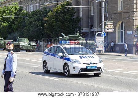 Donetsk, Donetsk People Republic, Ukraine - June 24, 2020: A Police Car Accompanies The Movement Of