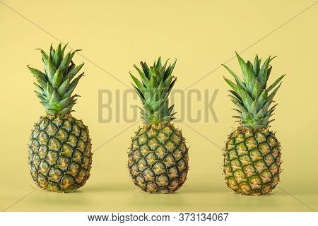 Pineapple Fruit Isolated On Yellow Background. Healthy Lifestyle Concept.