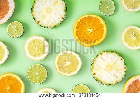 Collection Of Fresh Lime, Lemon, Orange, Citrus, Grapefruit, Pineapple Slice On Green Background.