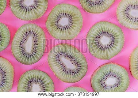 Collection Of Fresh Kiwi Slice Isolated On Pink Background.