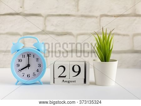 August 29 On A Wooden Calendar Next To The Alarm Clock. Summer Day, Empty Space For Text.calendar Fo