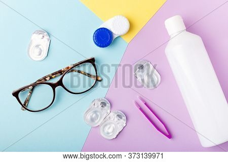 Contact Lens Kit With Bottle Of Lens Solution, Case, Tweezer On Multicolor Background, Copy Space, T