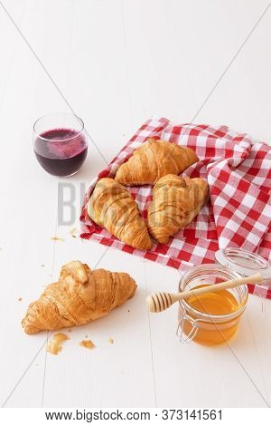 French Style Breakfast, A White Wooden Table With Glass Of Fresh Beetroot Smoothie, Croissants And G