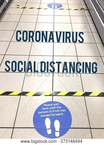 Social Distancing For Coronavirus Covid-19 In Grocery Supermarket Store Queue To Uk Coronavirus Gove