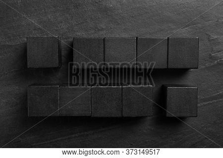 Flat Lay Composition With Cubes On Black Slate Background. Pareto Principle Concept