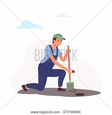 Worker Sows A Seed In The Ground. A Man Dug A Hole In The Garden With A Shovel And Bent To Plant A P